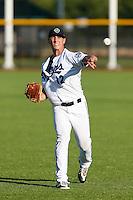 Will Locante #12 of the Hillsboro Hops before a game against the Spokane Indians at Hillsboro Ballpark on July 22, 2013 in Hillsboro Oregon. Spokane defeated Hillsboro, 11-3. (Larry Goren/Four Seam Images)