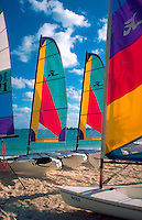 Colorful catamaran sailboats on beach. Nassau, Bahamas.