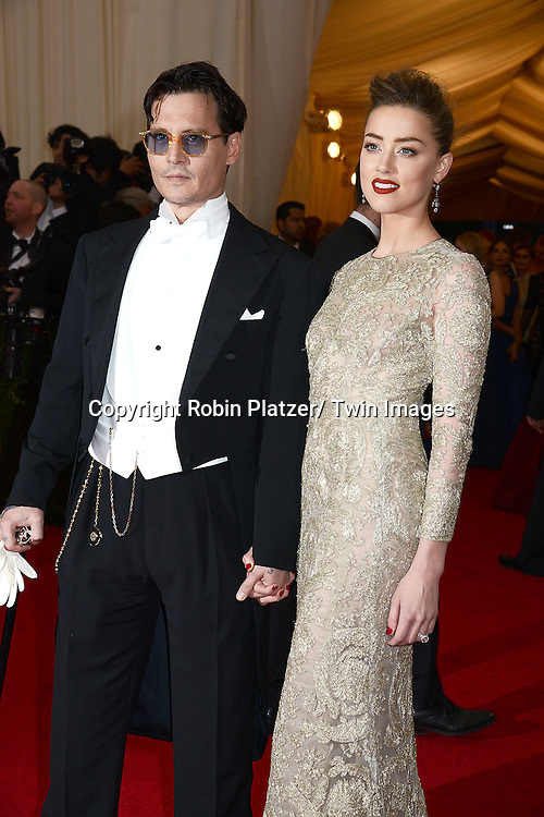 Johnny Depp and Amanda Heard attend the Costume Institute Benefit on May 5, 2014 at the Metropolitan Museum of Art in New York City, NY, USA. The gala celebrated the opening of Charles James: Beyond Fashion and the new Anna Wintour Costume Center.