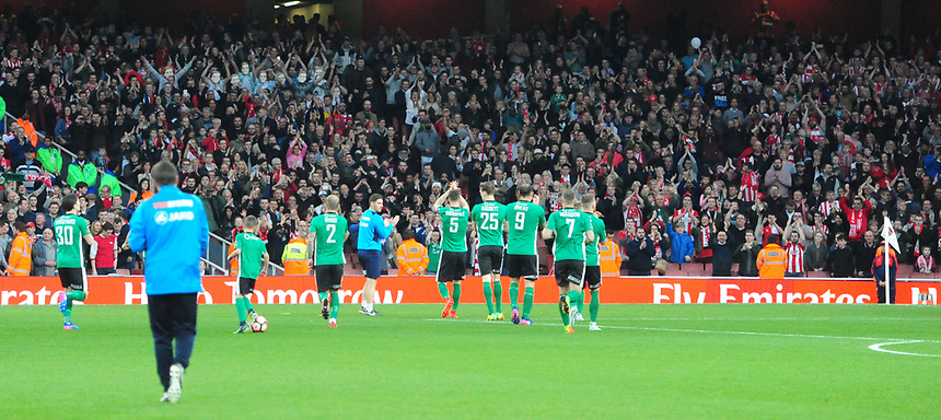 The Lincoln City player acknowledge the fans before kick off<br /> <br /> Photographer Chris Vaughan/CameraSport<br /> <br /> The Emirates FA Cup Quarter-Final - Arsenal v Lincoln City - Saturday 11th March 2017 - The Emirates - London<br />  <br /> World Copyright &copy; 2017 CameraSport. All rights reserved. 43 Linden Ave. Countesthorpe. Leicester. England. LE8 5PG - Tel: +44 (0) 116 277 4147 - admin@camerasport.com - www.camerasport.com