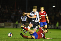 Jordan Stewart of Grimsby Town is challenged by Jake Gallagher of Aldershot Town during the Vanarama National League match between Aldershot Town and Grimsby Town at the EBB Stadium, Aldershot, England on 5 April 2016. Photo by Paul Paxford / PRiME Media Images.