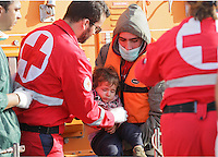 Pictured: A young child is helped by Red Cross personnel  Thursday 27 November 2014<br />