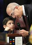 Nevada Sen. Mo Denis, D-Las Vegas, shows his son Dallin, 8, how the microphone at this desk in the Senate chambers works at the Legislature in Carson City, Nev. on Monday, Feb. 7, 2011. Lawmakers convened the 76th regular Legislative session on Monday. .Photo by Cathleen Allison