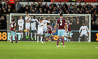 Pictured: Aaron Cresswell of West Ham (3) takes a free kick which hits the Swansea wall Saturday 10 January 2015<br />