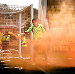 Albion Keeper Neil Parry dispenses with some smoke bombs in his goal