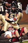 4 November 2006: Wake Forest's John Russell (51) ends up with the ball after Boston College quarterback Matt Ryan (12) was sacked near the goal line, but Ryan had been ruled down in the field of play. Wake Forest defeated Boston College 21-14 at Groves Stadium in Winston-Salem, North Carolina in an Atlantic Coast Conference college football game.