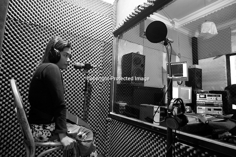Kompeak in a recording studio. She earns 15000 riels (around 4 dollars)  per DVD of Karaoke recorded and 2000 riels (half dollar) for each DVD sold (one DVD cost 2 dollars. Battambang, Cambodia - 2008