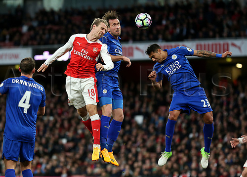 April 26th 2017, The Emirates, Arsenal, London England, EPL Premier League football, Arsenal FC versus Leicester City; Nacho Monreal of Arsenal beats Christian Fuchs of Leicester City and Leonardo Ulloa of Leicester City to head the ball from a cross