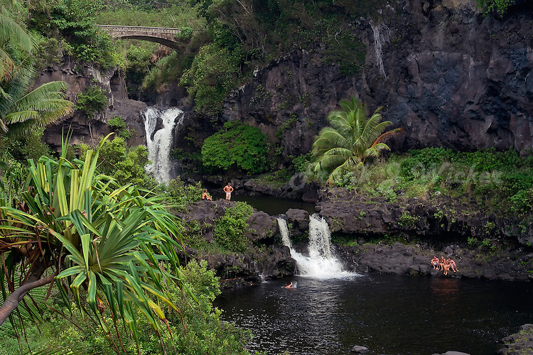 Swimmers enjoying tropical leisure at the seven pools in Ohe'o Gulch in HALEAKALA NATIONAL PARK on Maui in Hawaii USA