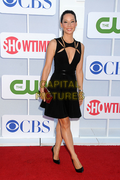 Lucy Liu.CBS, CW, Showtime 2012 Summer TCA Party held at The Beverly Hilton Hotel, Beverly Hills, California, USA..July 29th, 2012.full length dress clutch bag black cut out away low cut neckline cleavage maroon burgundy sleeveless .CAP/ADM/BP.©Byron Purvis/AdMedia/Capital Pictures.