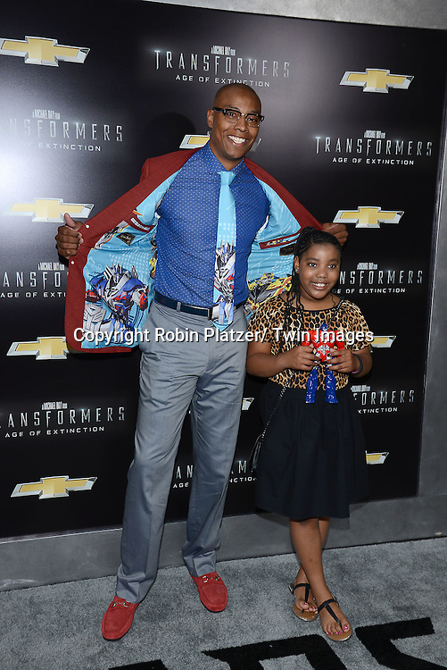 "Karon Butler and daughter attends the US Premiere of ""Transformers: Age of Extinction"" on June 25, 2014 at The Ziegfeld Theatre in New York City, New York, USA."