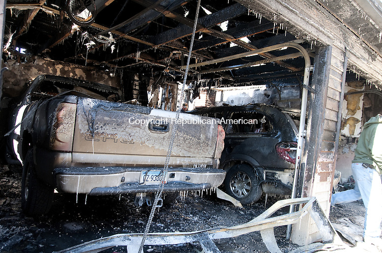 Bridgewater, CT - 28 Feb. 2014 - 022814AJ01 - A fast moving fire propelled by high winds early Friday morning ripped through a house on Henry Sanford Road in Bridgewater. There were no injuries, but the house and attached garage were destroyed.  Alec Johnson/ Republican American