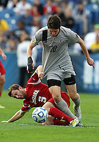 HOOVER, AL - DECEMBER 09, 2012: Matt McKain (5) of Indiana University grabs at Andy Riemer (20) of Georgetown University during the NCAA 2012 Men's College Cup championship, at Regions Park, in Hoover , AL, on Sunday, December 09, 2012.