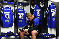 Sam Nixon of Bath Rugby reads the matchday programme in the changing rooms prior to the match. Gallagher Premiership match, between Bath Rugby and Wasps on May 5, 2019 at the Recreation Ground in Bath, England. Photo by: Patrick Khachfe / Onside Images