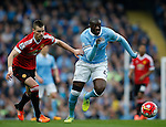 Yaya Toure of Manchester City tussles with Morgan Schneiderlin of Manchester United during the Barclays Premier League match at The Etihad Stadium. Photo credit should read: Simon Bellis/Sportimage