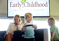 NWA Democrat-Gazette/BEN GOFF @NWABENGOFF<br /> Sara Lilygren, executive vice president for corporate affairs with Tyson Foods, Inc., looks on as Helen R. Walton Children's Enrichment Center students Whitten Smith, 2, (left) and Corey Harrington, 3, take the stage on Thursday Sept. 17, 2015 during a panel discussion on early childhood development at the future site of a new Helen R. Walton Children's Enrichment Center and Early Childhood Initiatives Center on N.E. J St. in Bentonville.