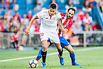 Victor Machin Perez Vitolo of Sevilla FC competes for the ball with Juan Francisco Torres Belen, Juanfran, of Atletico de Madrid during their La Liga match between Atletico de Madrid and Sevilla FC at the Estadio Vicente Calderon on 19 March 2017 in Madrid, Spain. Photo by Diego Gonzalez Souto / Power Sport Images