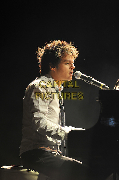 Jamie Cullum.Performing live in concert at The Forum, Kentish Town, London, England..18th October 2011.stage gig performance music in on half length grey gray shirt piano side profile singing sitting .CAP/MAR.© Martin Harris/Capital Pictures.