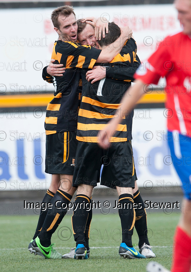 Alloa's Andy Kirk (centre) is congratulated by Graeme Holmes (left) and Kevin Cawley (7) after he scores their second goal.