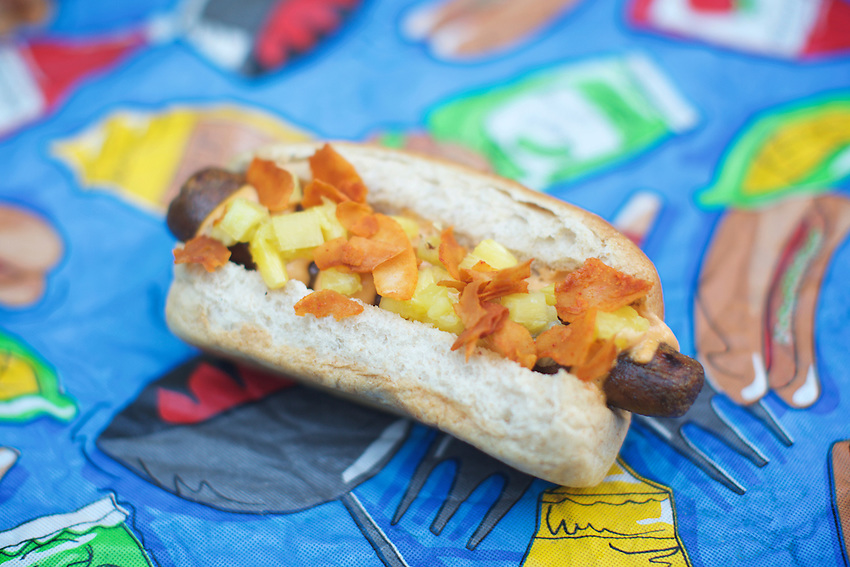 Brooklyn, NY - August 19, 2016:  The Viva Dawg by Vendy Awards Best Vegan nominee Yeah Dawg, topped with pickled pineapple, coconut bacon and chipotle mayo.<br /> <br /> CREDIT: Clay Williams for Gothamist.<br /> <br /> &copy; Clay Williams / claywilliamsphoto.com