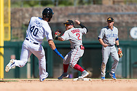 Mesa Solar Sox second baseman Esteban Quiroz (2), of the Boston Red Sox organization, throws to first base to try to complete a double play as Cody Thomas (40) runs to second base and shortstop Nico Hoerner (17) looks on during an Arizona Fall League game against the Glendale Desert Dogs at Camelback Ranch on October 15, 2018 in Glendale, Arizona. Mesa defeated Glendale 8-0. (Zachary Lucy/Four Seam Images)