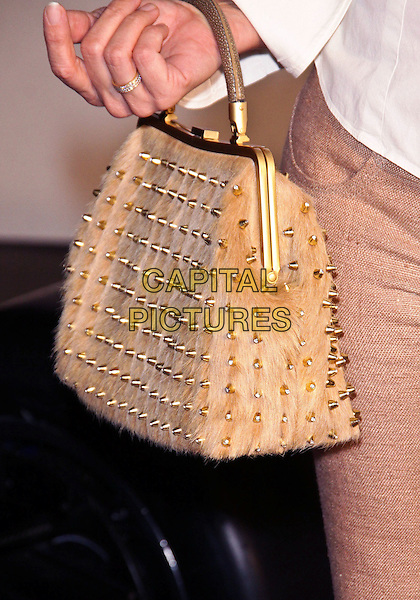 NICOLLETTE SHERIDAN's bag .US Launch Event for Lotus New Era  held at Stoneridge Estates,  Los Angeles, CA, USA, .12th November 2010..detail hand gold studs studded fur furry bag hand bag .CAP/ADM/TC.©T. Conrad/AdMedia/Capital Pictures.