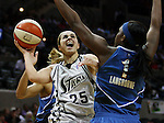 San Antonio's Becky Hammon (25) drives to the net past Washington's Crystal Langhorne (1) during the WNBA game between the San Antonio Silver Stars and the Washington Mystics, June 6, 2008, at the AT&T Center, San Antonio, Texas. San Antonio won 63 - 52. (Darren Abate/PressPhotoIntl.com)