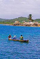 Dugout canoe with Kuna Indian village in background, San Blas Islands (Kuna Yala), Caribbean Sea, Panama