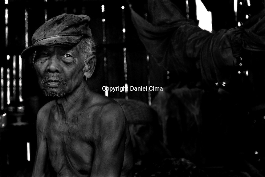Portrait of an old man (typhoon survivor) at home in .Da-Nang, The Socialist Republic of Vietnam. May 2007