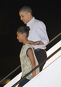 United States President Barack Obama and Sasha Obama head down the jetway after arriving on Air Force One from Washington at Joint Base Pearl Harbor-Hickam, December 22, 2012.  The First Family is scheduled to be vacationing in Hawaii through the New Year..Credit: Cory Lum / Pool via CNP