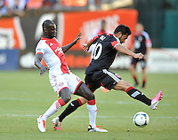 Carlos Riuiz (20) of D.C. United goes against Pa Modou Kah (44) of the Portland Timbers. The Portland Timbers defeated D.C. United 2-0, at RFK Stadium, Saturday May 25 , 2013.