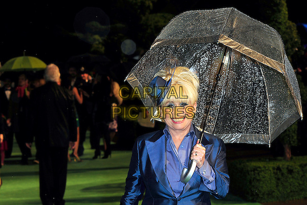 "BARBARA WINDSOR .Arriving at the Royal World Film Premiere of ""Alice In Wonderland"", Odeon cinema Leicester Square, London, England, February 26th 2010. arrivals half length holding umbrella raining blue hat smiling make-up jacket shirt silk fascinator.CAP/CJ.©Chris Joseph/Capital Pictures."