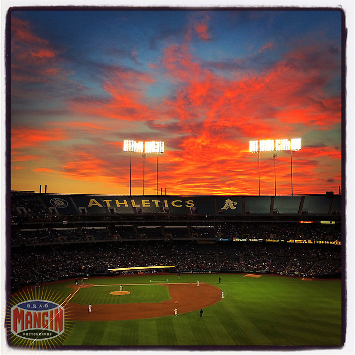 OAKLAND, CA - AUGUST 4: Instagram of the sun setting with pink and orange clouds during the game between the Tampa Bay Rays and Oakland Athletics at O.co Coliseum on August 4, 2014 in Oakland, California. Photo by Brad Mangin