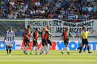 VOETBAL: HEERENVEEN: Abe Lenstra Stadion, 12-08-2012, Eredivisie, seizoen 2012/2013, sc Heerenveen - NEC, Eindstand 0-2, spandoek met tekst 'Michel en Geert Arend bedankt voor jullie jarenlange inzet', felicitaties voor Pavel Cmovs (#17) die de 0-2 scoort, Geert Arend Roorda (#10), Michel Breuer (#21), scheidsrechter Tom van Sichem, ©foto Martin de Jong