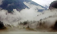 Autumn mists swirl in Thunder Arm valley in North Cascades National Park, Washington State.