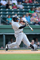 First baseman Leonard (Bo) Thompson (38) of the Charleston RiverDogs bats in a game against the Greenville Drive on Sunday, August 16, 2015, at Fluor Field at the West End in Greenville, South Carolina. Thompson is a product of The Citadel and J.L. Mann High School in Greenville. Charleston won, 6-2. (Tom Priddy/Four Seam Images)