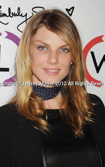 WEST HOLLYWOOD, CA - NOVEMBER 14: Angela Lindvall attends the opening of Kimberly Snyder's Glow Bio Juice Bar at Glow Bio on November 14, 2012 in West Hollywood, California.