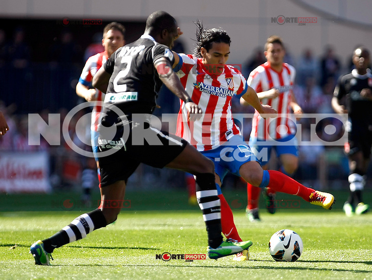 Atletico's Falcao and Granada's Nyom during La Liga BBVA match. April 14, 2013.(ALTERPHOTOS/Alconada)