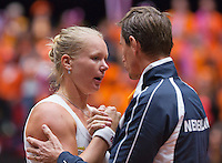Netherlands, Den Bosch, April 18 2015 Maaspoort, Fedcup Netherlands-Australia,  Kiki Bertens (NED)  is congretulated by captain Paul Haarhuis<br /> Photo: Tennisimages/Henk Koster