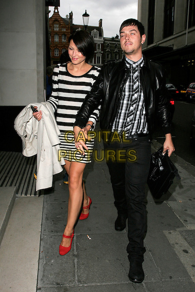 EMMA GRIFFITHS & MATT WILLIS.ITV2 Autumn Launch Party, The Roof Gardens, London, England..August 19th, 2008.full length jeans denim jacket black leather white striped stripes dress red shoes holding hands married husband wife couple plaid checkered shirt blinking eyes closed funny face .CAP/AH.©Adam Houghton/Capital Pictures.