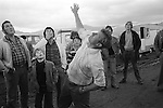Appleby in Westmorland. 1981  <br /> A gypsy throws two pennies up; its a game of chance. If both coins land heads up or tails up you win depending on your call. Heads and tails everyone looses apart from the thrower upper of the coins.