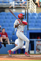 Philadelphia Phillies outfielder Domonic Brown (9) flies out in the first inning while on rehab assignment with the Clearwater Threshers during a game against the Dunedin Blue Jays on April 10, 2015 at Florida Auto Exchange Stadium in Dunedin, Florida.  Clearwater defeated Dunedin 2-0.  (Mike Janes/Four Seam Images)