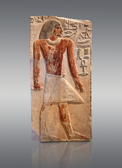 Ancient Egyptian tomb relief sculpture depicting the scribe and judge Ankhirptah. Middle Kingdom Egypt, 2170 BC. Neues Museum Berlin Cat No: AM 7337.