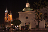 After dark in the central square of Krakow highlights the two churches
