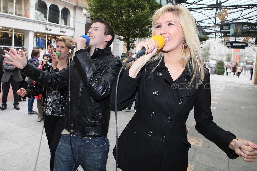 13/10/2010. Crystal Swing Busking. Fans dance with Mary, Derek and Dervla Burke from Cork band Crystal Swing as they launch the busking contest outside the Gaiety Theatre, Dublin for the Mooney radio show on RTE. Picture James Horan/Collins Photos