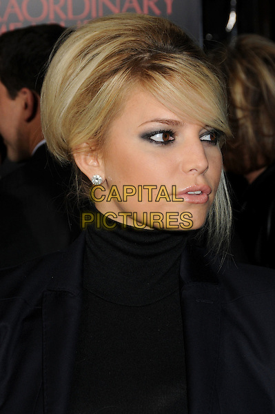 "JESSICA SIMPSON.""Extraordinary Measures"" Los Angeles Premiere held at Grauman's Chinese Theatre, Hollywood, California, USA..January 19th, 2010.headshot portrait black high collar beehive teased hair big sweeping fringe diamond stud earring .CAP/ADM/BP.©Byron Purvis/AdMedia/Capital Pictures."