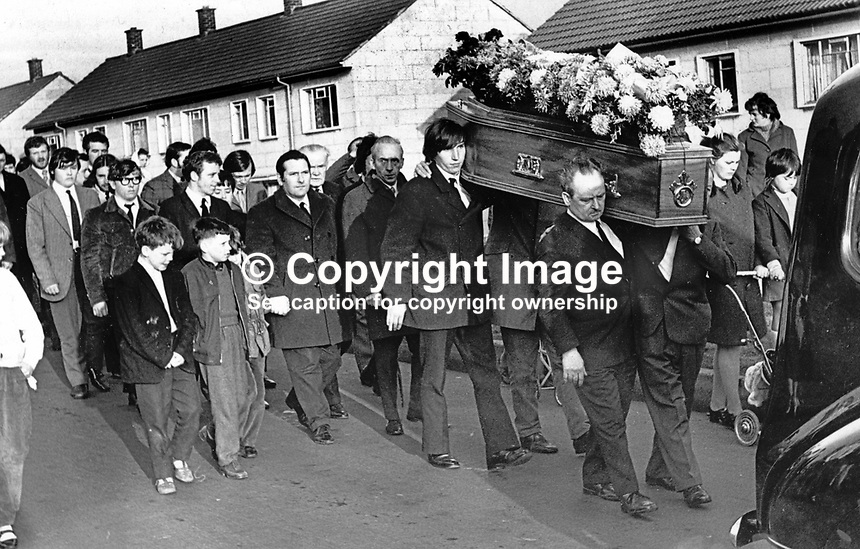 Funeral of Sean Russell, a 30 year old Roman Catholic member of the UDR moves off from his home in the New Barnsley estate in West Belfast, N Ireland. Mr Russell was one of a small number of Roman Catholics to join the UDR in the early days of the Troubles and the first of his co-religionists in the regiment to die. Mr Russell was shot dead by a masked gunman, almost certainly a member of the Provisional IRA, as he sat watching television. 197112100500SR2<br />