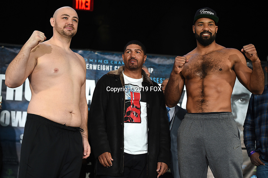 BROOKLYN - JANUARY 25: Boxers Adam Kownacki and Gerald Washington at the weigh-in for the January 26 PBC on FOX fight card at Barclays Arena on January 25, 2019, in Brooklyn, New York. (Photo by Frank Micelotta/Fox Sports/PictureGroup)