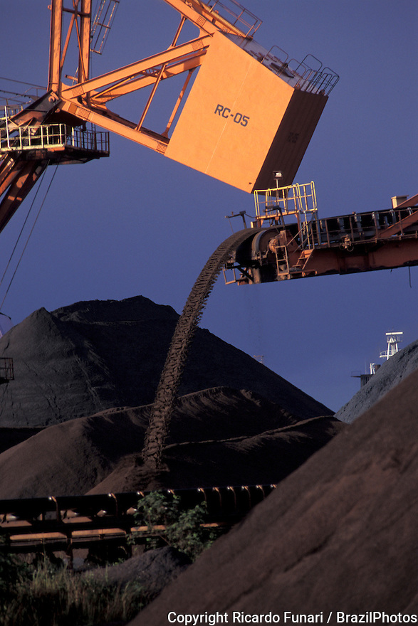 Mining, Brazilian commodity - conveyor belt, transportation of iron ore for exportation at Tubarao Harbour in Vitoria city, Espirito Santo State, Brazil.