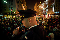 Thousands of people waited in the streets from the early hours of the morning in frigid temperatures to see the inauguration of Barack Obama as the 44th President of the United States. 42,500 police and security personnel watched over the crowd.